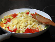 Stir fried seasonal vegetables. In a pan on the stove stock photography