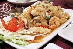 Stir fried shrimp and squid in holy basil - thai food. Seafood stir fried shrimp and squid in holy basil - thai food Royalty Free Stock Photography