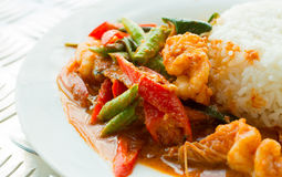 Stir fried shrimp in thai red curry paste , Royalty Free Stock Photos