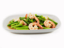 Stir fried shrimps with asparagus in plate on white Royalty Free Stock Photography