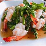 Stir fried shrimps. Stir fried shrimps with fresh chili and pepper stock images