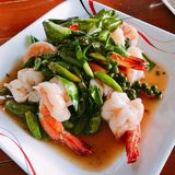Stir fried shrimps. Stir fried shrimps with fresh chili and pepper royalty free stock photos