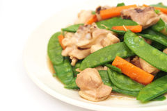 Stir fried snow peas with chicken Stock Photos