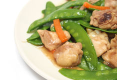 Stir fried snow peas with chicken Stock Image