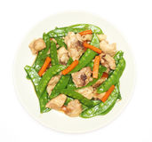 Stir fried snow peas with chicken Royalty Free Stock Photo