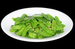 Stir fried snow peas. And minced garlic isolated black background, Vietnamese cuisine royalty free stock photography