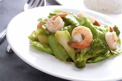 Stir fried snow peas with shrimp. Stir fried snow peas and broccoli with shrimp royalty free stock image