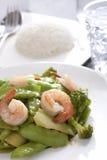 Stir fried snow peas with shrimp. Stir fried snow peas and shrimp served with rice royalty free stock image