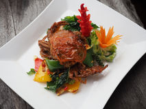 Stir fried soft shell crab with fresh young pepper sauce. Stir fried soft shell crab with fresh young pepper sauce, Thai style spicy dish. top view Royalty Free Stock Photography