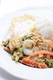 Stir-fried Soft-shelled seafood in curry powder & Thai jasmine rice.  Stock Image