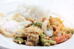 Stir-fried Soft-shelled seafood in curry powder & Thai jasmine rice.  Royalty Free Stock Photography