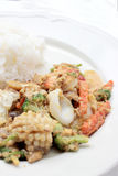 Stir-fried Soft-shelled seafood in curry powder & Thai jasmine rice.  Royalty Free Stock Image