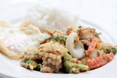 Stir-fried Soft-shelled seafood in curry powder & Thai jasmine rice.  Stock Images