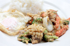 Stir-fried Soft-shelled seafood in curry powder & Thai jasmine rice.  Royalty Free Stock Images