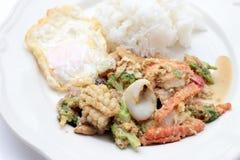 Stir-fried Soft-shelled seafood in curry powder & Thai jasmine rice.  Stock Photos