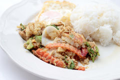 Stir-fried Soft-shelled seafood in curry powder & Thai jasmine rice. Thai Food Royalty Free Stock Images