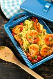 Stir-fried spaghetti with grilled shrimps and tomatoes - Italian fusion food style. Stir-fried spaghetti with grilled shrimps and tomatoes - Italian fusion food stock photo
