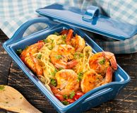 Stir-fried spaghetti with grilled shrimps and tomatoes - Italian fusion food style. Stir-fried spaghetti with grilled shrimps and tomatoes - Italian fusion food stock images