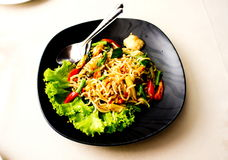 Stir-Fried Spaghetti with Snapper. On black dish Royalty Free Stock Photos