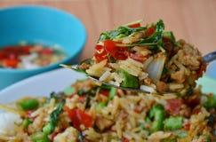 Stir-fried spicy minced pork with basil leaf and rice on spoon. Stir-fried spicy minced pork with basil leaf and rice on the spoon stock images