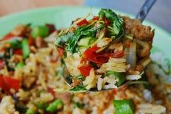 Stir-fried spicy minced pork with basil leaf and rice on spoon. Stir-fried spicy minced pork with basil leaf and rice on the spoon stock photography