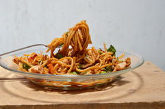 Stir fried spicy spaghetti with pork and chili in fork Stock Photography