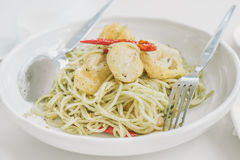 Stir Fried Spicy Spaghetti with scallop tempura. On white bowl and background Royalty Free Stock Images