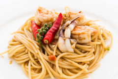 STIR FRIED SPICY SPAGHETTI WITH SEAFOOD Royalty Free Stock Photos