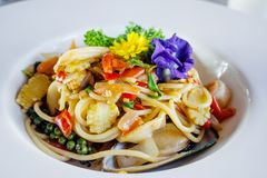 Stir-fried spicy spaghetti with seafoods royalty free stock photo