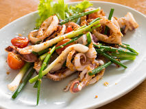 Stir fried squid with green onions Stock Image