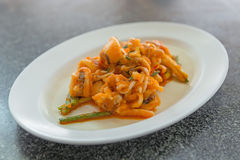 Stir fried squid with salted egg yolk Thai cuisine Royalty Free Stock Images