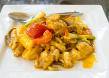 Stir fried squid with salted egg yolk. Thai food - Stir fried squid with salted egg yolk Royalty Free Stock Photos