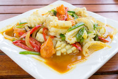 Stir fried squid with salted egg yolk. Stir fried squid with salted egg, Thai food Royalty Free Stock Image