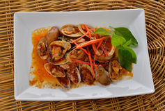 Stir Fried Surf Clams with Roasted Chili Paste on plate Royalty Free Stock Photography