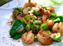 Stir fried Thai flat beans with shrimp and Shri paste. Royalty Free Stock Image
