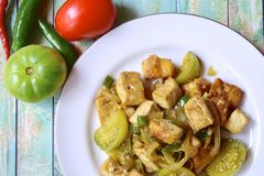 Stir fried tofu or Oseng Tahu. Stir-fried tofu with green tomato and chili or Oseng Tahu, Indonesian food Royalty Free Stock Image