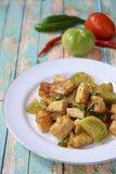 Stir fried tofu or Oseng Tahu. Stir-fried tofu with green tomato and chili or Oseng Tahu, Indonesian food Royalty Free Stock Photography