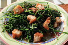 Stir-fried vegetable fern in oyster sauce with crispy Pork Stock Photo