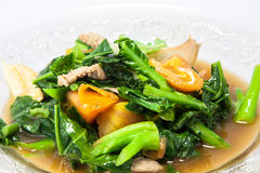 Stir-fried vegetables. Pork fried kale and tomatoes in glass dish Stock Image