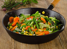 Stir fried vegetables in  a iron skillet Stock Photos