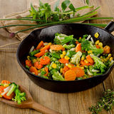 Stir fried vegetables in  iron skillet . Stock Photos