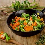 Stir fried vegetables in  iron skillet . Stock Photos