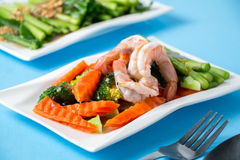 Stir fried vegetables with shrimp. In a white dish Stock Images