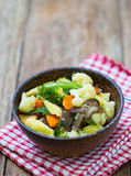 Stir-fried vegetables in wood cup Royalty Free Stock Photos
