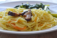 Stir fried vegetarian noodle with mushroom and Chinese cabbage on dish Royalty Free Stock Image