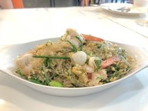Stir fried vermicelli with pickled garlic,bitter bean,Acacia pennata and sea food,thai food.  stock photography