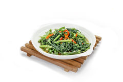 Stir Fried Water Spinach or pak boong fai daeng on background Stock Photo
