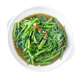 Stir Fried Water Spinach or pak boong fai daeng on white dish Stock Photo
