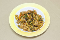 Stir Fried Wild Boar with Red Curry in plastic dish on card boar Royalty Free Stock Photos