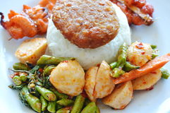 Stir fried yard long bean fish ball and pork with grilled chicken stick on rice Royalty Free Stock Photography
